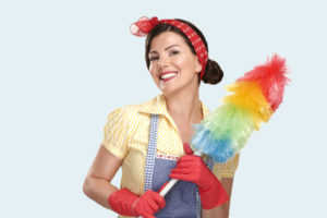 young house maid with duster